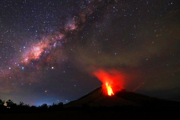 Hot lava flows down the Mount Sinabung volcano in the night in Karo, North Sumatra on July 30, 2017. (TIBTA PANGIN/AFP/Getty Images)