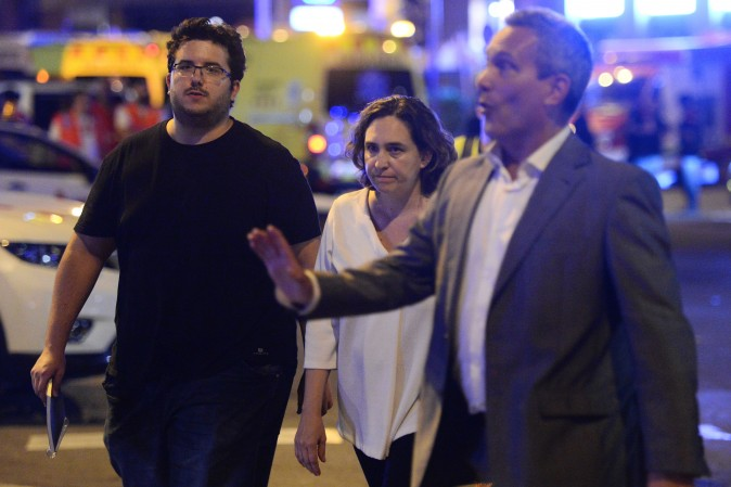 Barcelona's Mayor Ada Colau (C) arrives on the Rambla boulevard after a van ploughed into the crowd, killing at least 13 people and injuring around 100 others on the Rambla in Barcelona on August 17, 2017. (JOSEP LAGO/AFP/Getty Images)