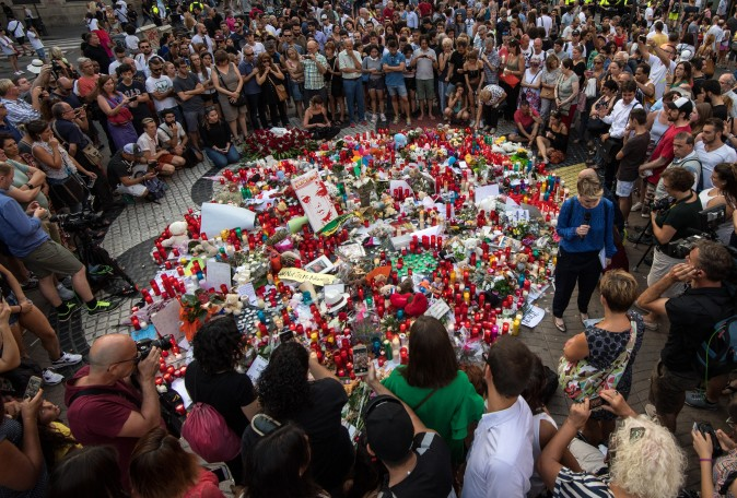 People gather around tributes laid on Las Ramblas near the scene of yesterday's terrorist attack, on August 18, 2017 in Barcelona, Spain. (Carl Court/Getty Images)