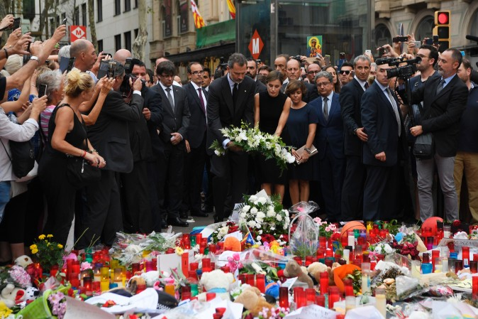Spain's King Felipe VI and Queen Letizia stand at a memorial for the victims of the Barcelona attack on Las Ramblas boulevard in Barcelona on Aug. 19, 2017, two days after a van ploughed into the crowd, killing 13 persons and injuring over 100. (LLUIS GENE/AFP/Getty Images)