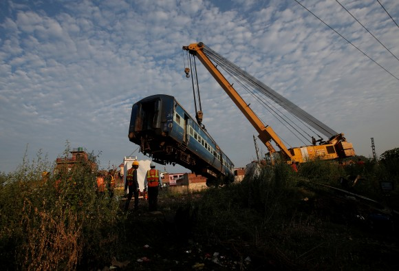 A damaged coach of a passenger train is removed from the site of an accident in Khatauli, in the northern state of Uttar Pradesh, India August 20, 2017. (Reuters/Adnan Abidi)