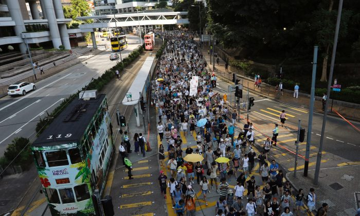 "Demonstrators march in protest of the jailing of student leaders Joshua Wong, Nathan Law and Alex Chow, who were imprisoned for their participation of the 2014 pro-democracy Umbrella Movement, also known as ""Occupy Central"" protests, in Hong Kong China August 20, 2017. (Reuters/Tyrone Siu)"