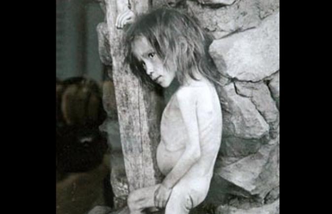 Starving Russian girl in Buguruslan, 1921 (Public Domain)