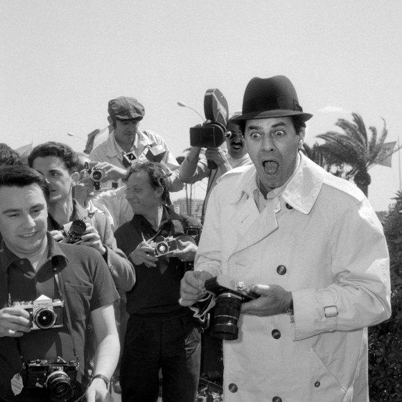 U.S. comedian, director, and singer Jerry Lewis jokes with photographers on Sept. 23, 1965, upon his arrival at the International Cannes Film Festival. (STF/AFP/Getty Images)