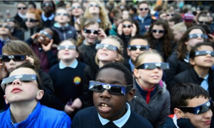 Children wear their special solar eclipse viewing glasses. (Courtesy Mark Margolis / Rainbow Symphony)