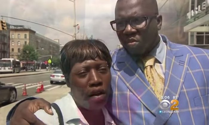 Ebony Merritt and Rev. Kevin McCall stand outside of Harlem Hospital in New York City. (Screenshot via YouTube/CBS New York)