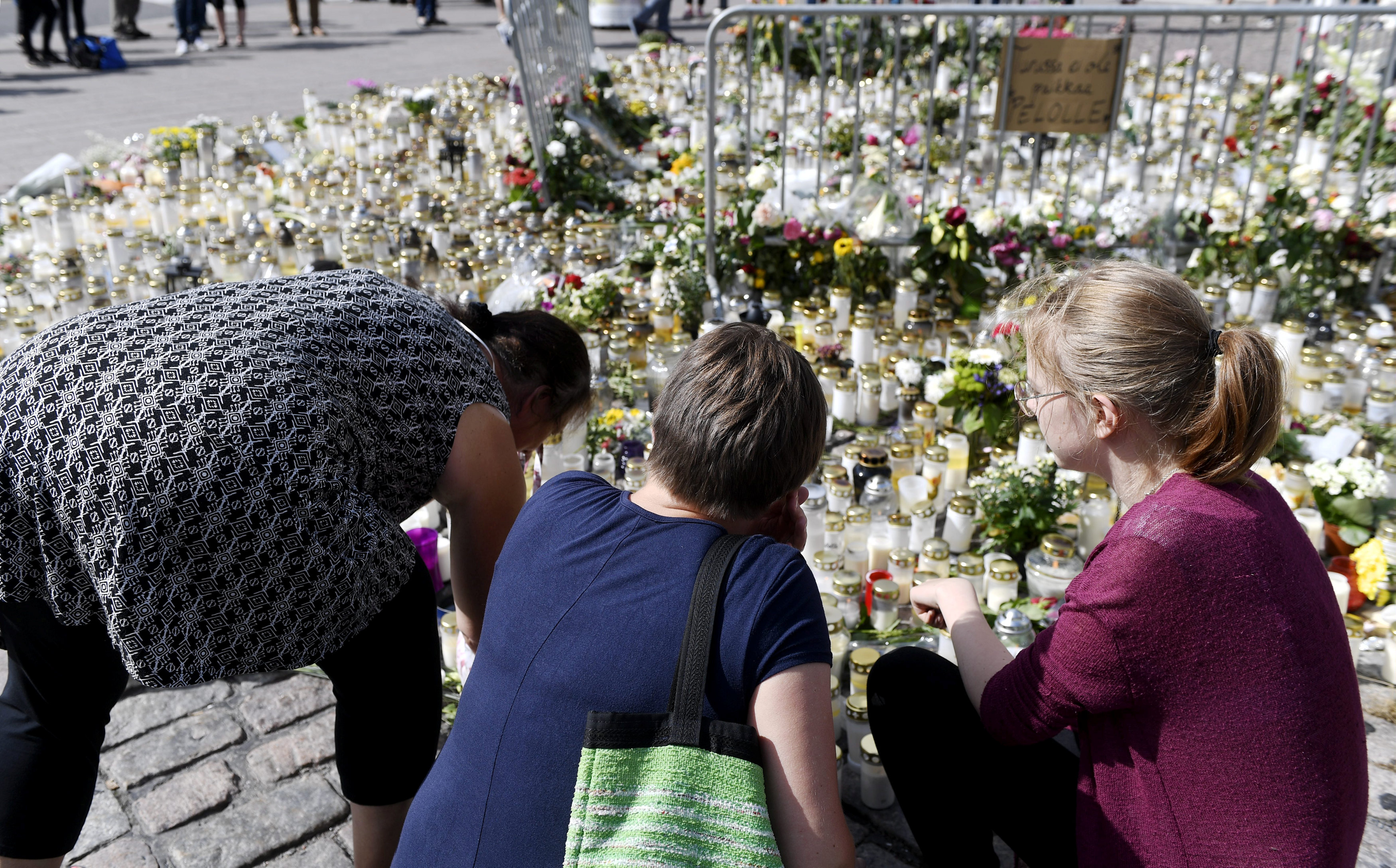 Mourners bring memorial cards, candles and flowers to the Turku Market Square, in Turku, Finland  on August 20, 2017. (Lehtikuva/Vesa Moilanen)