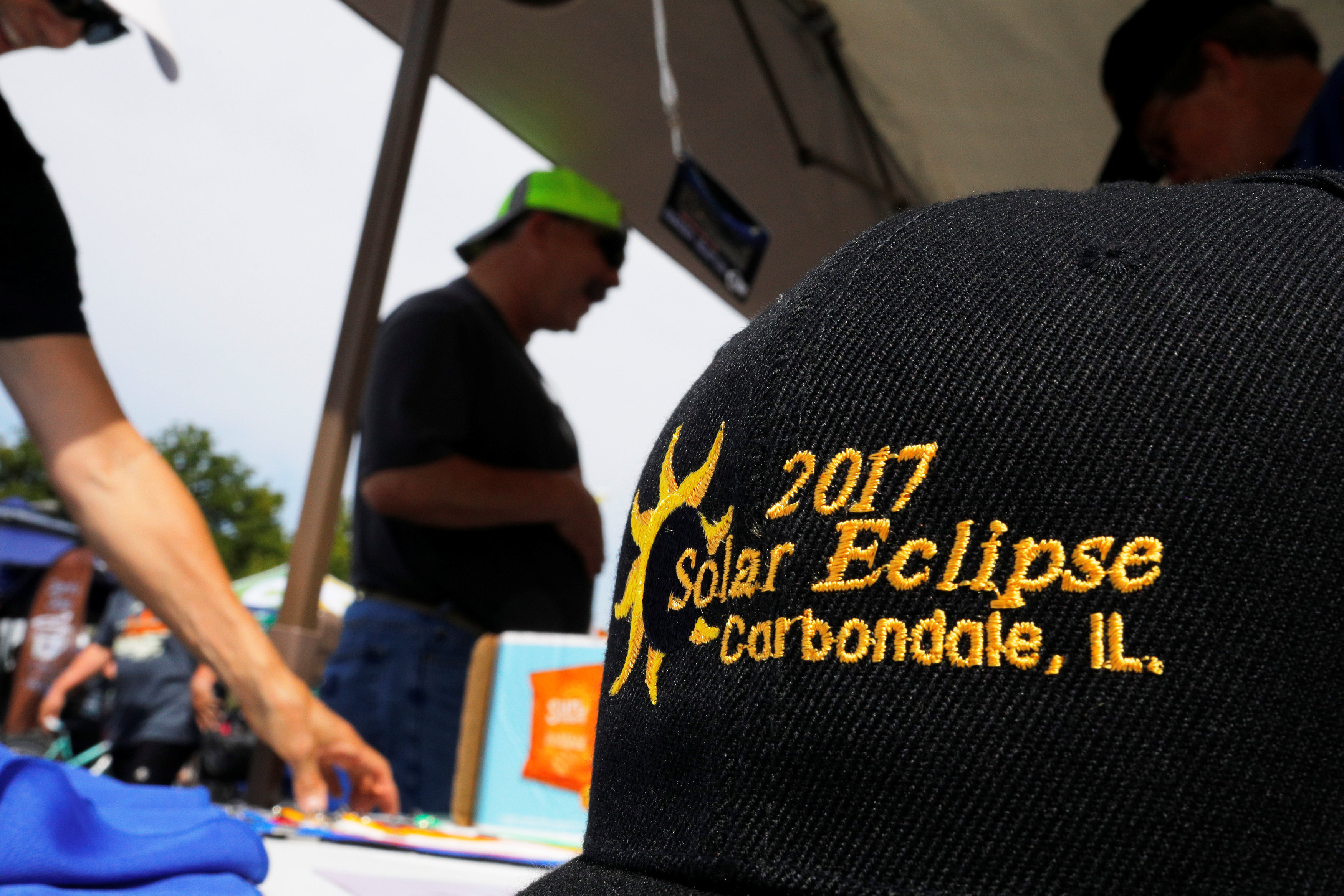 The Rotary Club sells commemorative baseball caps in Carbondale, Illinois, U.S., August 20, 2017, one day before the total solar eclipse. REUTERS/Brian Snyder