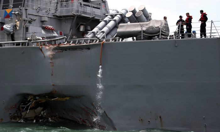 The U.S. Navy guided-missile destroyer USS John S. McCain is seen after a collision, in Singapore waters on August 21, 2017. (REUTERS/Ahmad Masood)