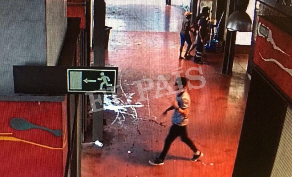 A watermarked CCTV frame grab provided by Spanish newspaper El Pais shows a suspect walking through La Boqueria market seconds after a van crashed into pedestrians in Barcelona, Spain, Aug. 17, 2017. (Courtesy of El Pais via REUTERS)