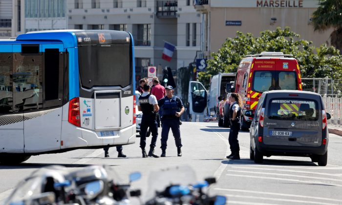 French police secure the area in the French port city of Marseille, France, August 21, 2017 where one person was killed and another injured after a car crashed into two bus shelters.   (REUTERS/Philippe Laurenson)