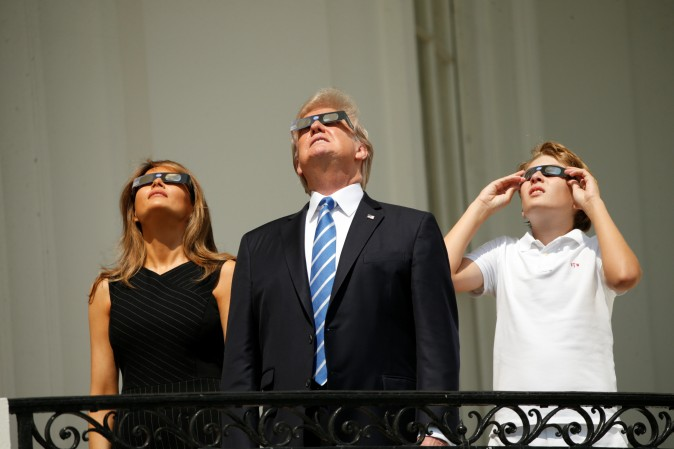 U.S. President Donald Trump watches the solar eclipse with first Lady Melania Trump and son Barron from the Truman Balcony at the White House in Washington, U.S., August 21, 2017 REUTERS/Kevin Lamarque