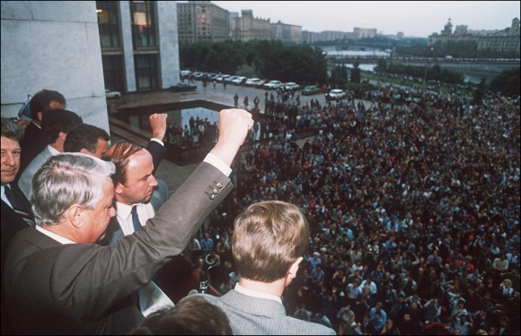 A defiant Russian President Boris Yeltsin (L) clenches a fist to his supporters from the Russian Federation building 19 August 1991 in Moscow calling on them for a general strike and to resist the pro-communist coup against Soviet President Gorbachev. (Dima Tanin/AFP/Getty Images)