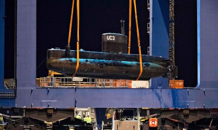 The Submarine UC3 Nautilus is lifted onto a block truck from the salvage ship Vina with the help of a container crane in Copenhagen's Harbor, on August 12, 2017. (JENS NOERGAARD LARSEN/AFP/Getty Images)