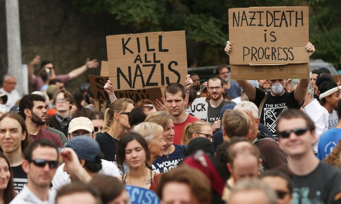 Thousands of protesters prepare to march in Boston against a planned Free Speech Rally just one week after the violent 'Unite the Right' rally in Virginia left one woman dead and dozens more injured on August 19, 2017 in Boston, United States. Rally organizers stressed that they are not associated with any alt-right or white supremacist groups.  (Spencer Platt/Getty Images)