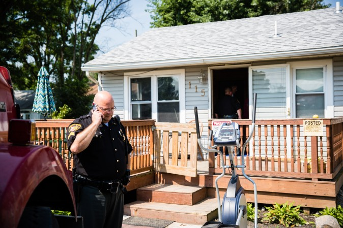 Law enforcement officials at the home of a man who was found dead from an apparent drug overdose in the Drexel neighborhood of Montgomery County, Ohio, on Aug. 3, 2017. (Benjamin Chasteen/The Epoch Times)