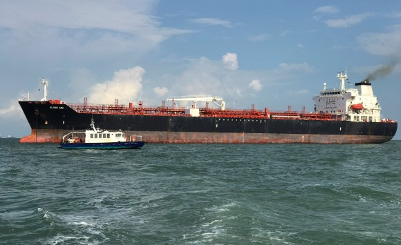Tanker Alnic MC is seen in Singapore waters after a collision with U.S. Navy USS John S. McCain, August 21, 2017. (Reuters/Christoph Van Der Perre)