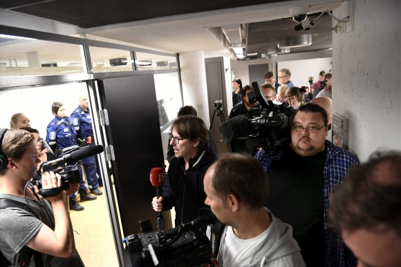 Press and and police pictured before the initial remand hearing of Abderrahman Mechkah (lying in a hospital bed, attending the court session via video), 18 year-old Moroccan man suspected of killing two people and attempting to kill eight others with terrorist intent in Turku, on Friday, August 19, is held at Southwest Finland District Court in Turku, Finland, August 22, 2017. (Lehtikuva/Martti Kainulainen via Reuters)