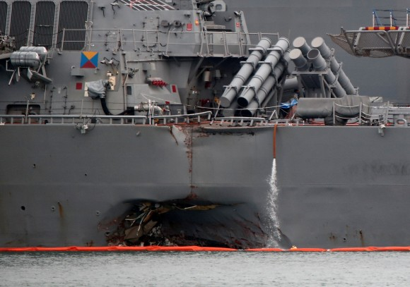 The damaged USS John McCain is docked at Changi Naval Base in Singapore August 22, 2017. (Reuters/Calvin Wong)