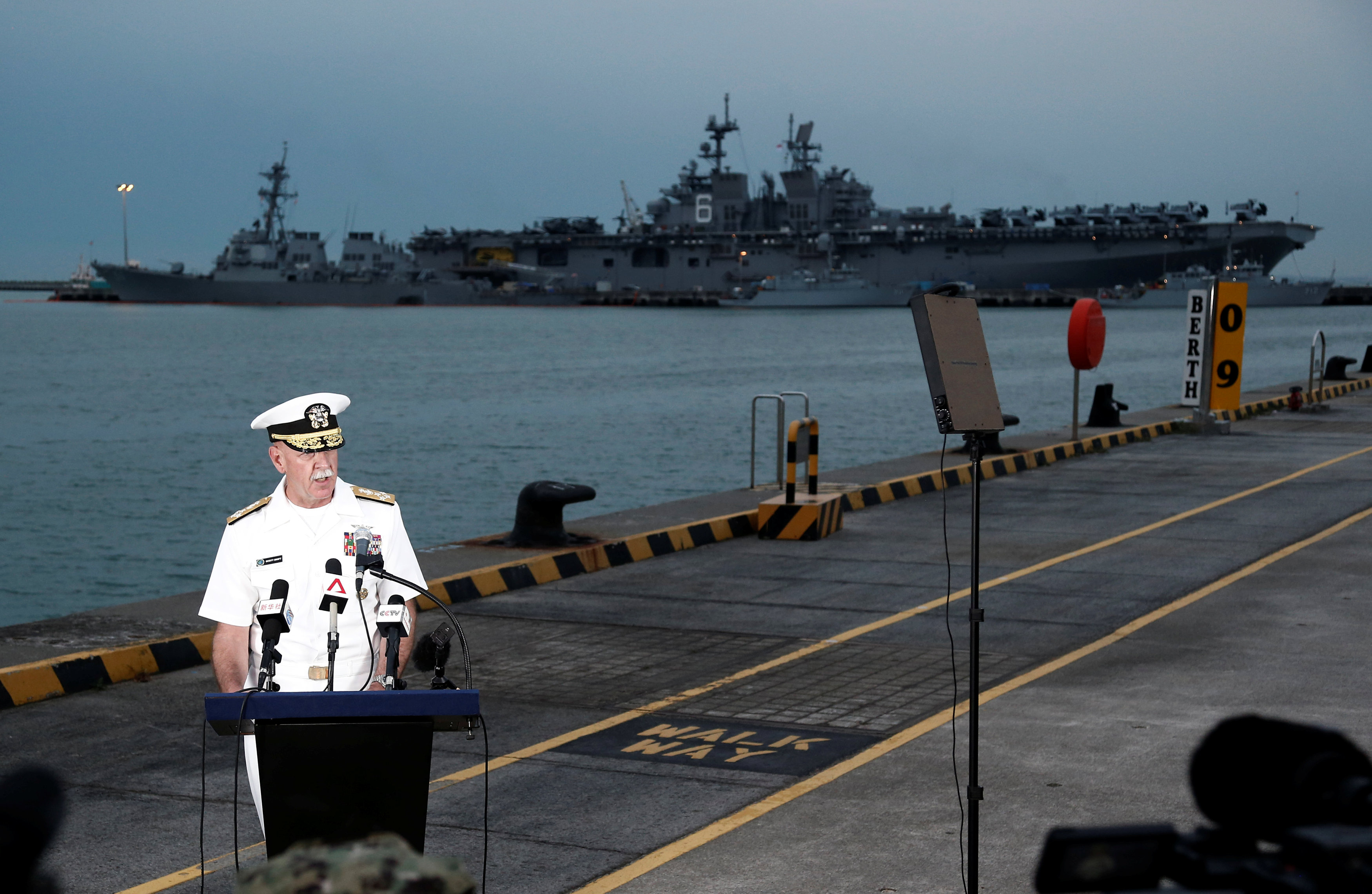 Admiral Scott Swift, Commander of the U.S. Pacific Fleet, speaks at a news conference near the damaged USS John McCain and the USS America at Changi Naval Base in Singapore on August 22, 2017. (REUTERS/Calvin Wong)