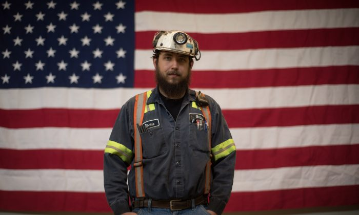 Donnie Claycomb, 27, of Limestone, West Virginia., who has been mining for 6 years, stands in front of an American flag prior to an event with U.S. Environmental Protection Agency Administrator Scott Pruitt at the Harvey Mine in Sycamore, Pennsylvania, on April 13, 2017. (Justin Merriman/Getty Images)