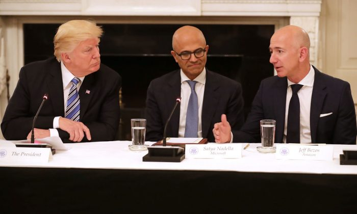 President Donald Trump, Microsoft CEO Satya Nadella, and Amazon CEO Jeff Bezos attend a meeting of the American Technology Council in the State Dining Room of the White House in Washington, DC, on June 19, 2017. (Chip Somodevilla/Getty Images)