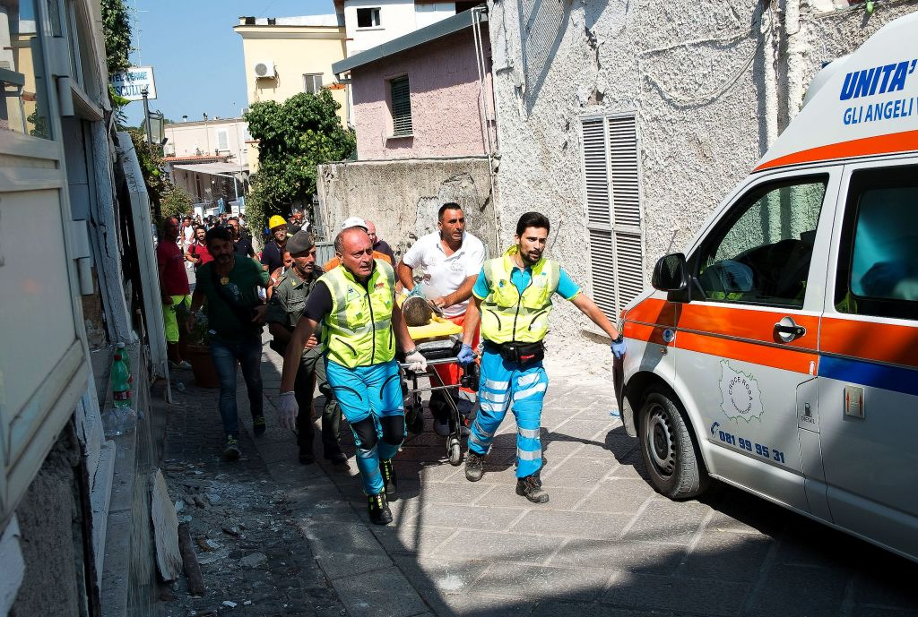 Italian emergency workers evacuate on a stretcher Mattias, a 7-year-old boy who was trapped by rubble, in Casamicciola Terme, on the Italian island of Ischia, on August 22, 2017. (ELIANO IMPERATO/AFP/Getty Images)