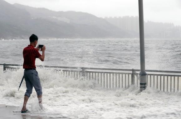 A man takes photo after Typhoon Hato hits Hong Kong, China August 23, 2017. (Reuters/Tyrone Siu)