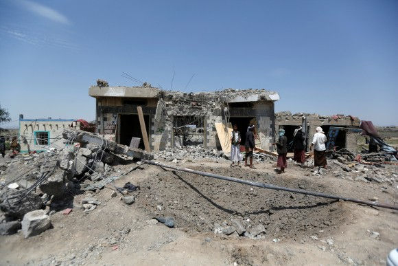 People stand at the site of Saudi-led air strikes in Arhab area, around 20 kilometres (13 miles) north of Sanaa, Yemen August 23, 2017. (Reuters/Khaled Abdullah)