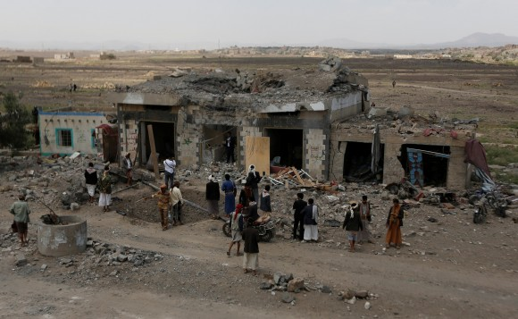 People gather at the site of Saudi-led air strikes in Arhab area, around 20 kilometres (13 miles) north of Sanaa, Yemen August 23, 2017. (Reuters/Khaled Abdullah)