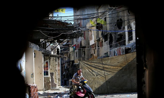 A man rides on a motorbike inside the Ain el-Hilweh refugee camp near Sidon, southern Lebanon, August 23, 2017. (Reuters/Ali Hashisho)