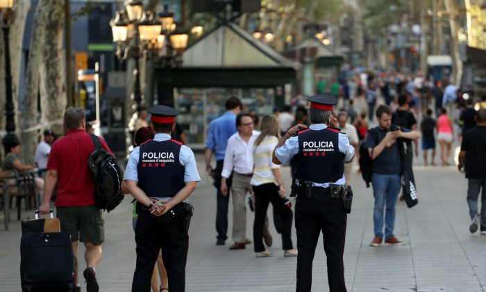 FILE PHOTO: Catalan Mossos d'esquadra officers patrol at Las Ramblas street where a van crashed into pedestrians in Barcelona, Spain August 18, 2017. (Reuters/Sergio Perez)