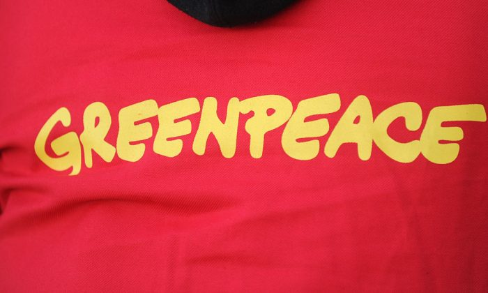 A picture taken in Douarnenez, western France on May 23, 2016 shows the logo of the non-governmental environmental organization Greenpeace on the jersey of an activist. (FRED TANNEAU/AFP/Getty Images)