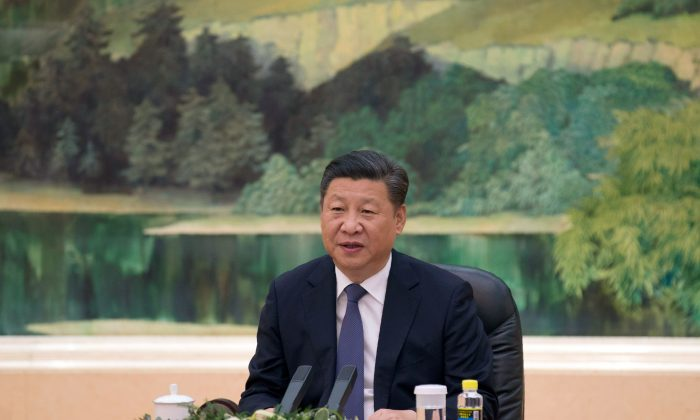 Chinese leader Xi Jinping at the Great Hall of the People in Beijing on July 28. (Andy Wong/AFP/GETTY IMAGES)