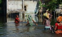 Villagers wade through flood waters at Alal village in the Indian state of West Bengal on Aug. 23, 2017. More than 750 people have died in floods across South Asia, officials said Aug. 21. The human toll is steadily rising across India, Nepal, and Bangladesh following the latest in a series of deluges since August 10, as the annual monsoon hits the north and east of the region. (DIPTENDU DUTTA/AFP/Getty Images)