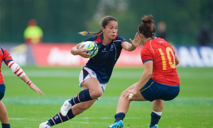Rose-hopewell-fong-of Hong Kong battles-past-her-opposite-no-20-patricia-garcia-of-Spain in the 9th place semi-final of the Women's Rugby World Cup, in Belfast, on Tuesday Aug 22, 2017. (Hong Kong Rugby)