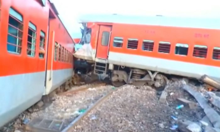 A passenger express train derailed after hitting a truck in northern India on Aug. 23, 2017. (Video screenshot / Reuters video)