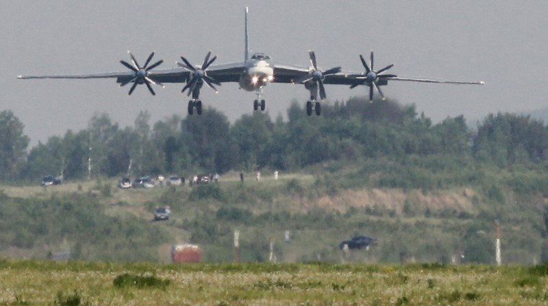 A Tupolev Tu-95MS strategic bomber, the carrier of nuclear rockets, lands at the Yemelyanovo airport near Russia's Siberian city of Krasnoyarsk on June 8, 2011. (REUTERS/Ilya Naymushin)