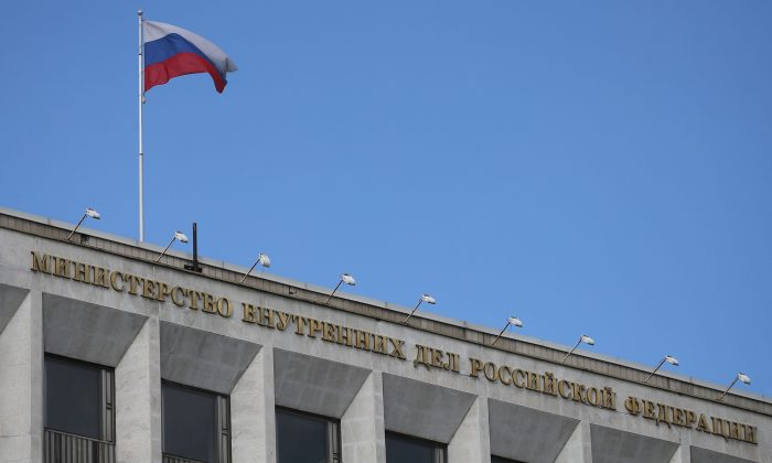 A Russian national flag flutters in the wind on top of the Russian Interior Ministry building on May 13, 2017 in Moscow. (STR/AFP/Getty Images)