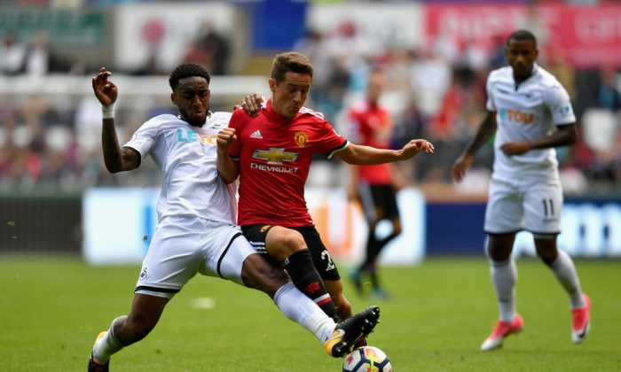 Leroy Fer of Swansea City (in white) and Ander Herrera of Manchester United battle for possession during the Premier League match between Swansea City and Manchester United at Liberty Stadium on Aug 19, 2017 in Swansea, South Wales. (Dan Mullan/Getty Images)