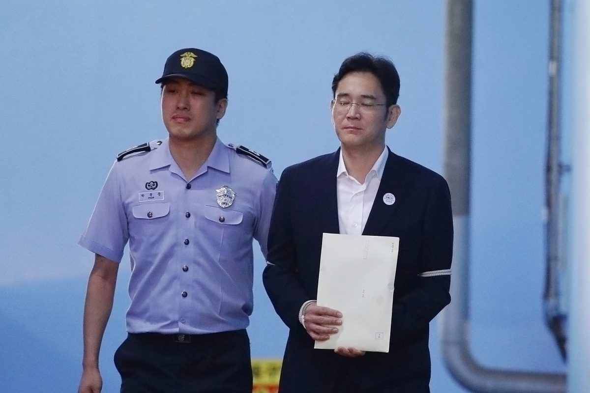 Lee Jae-yong, Samsung Group heir, leaves after his verdict trial at the Seoul Central District Court in Seoul