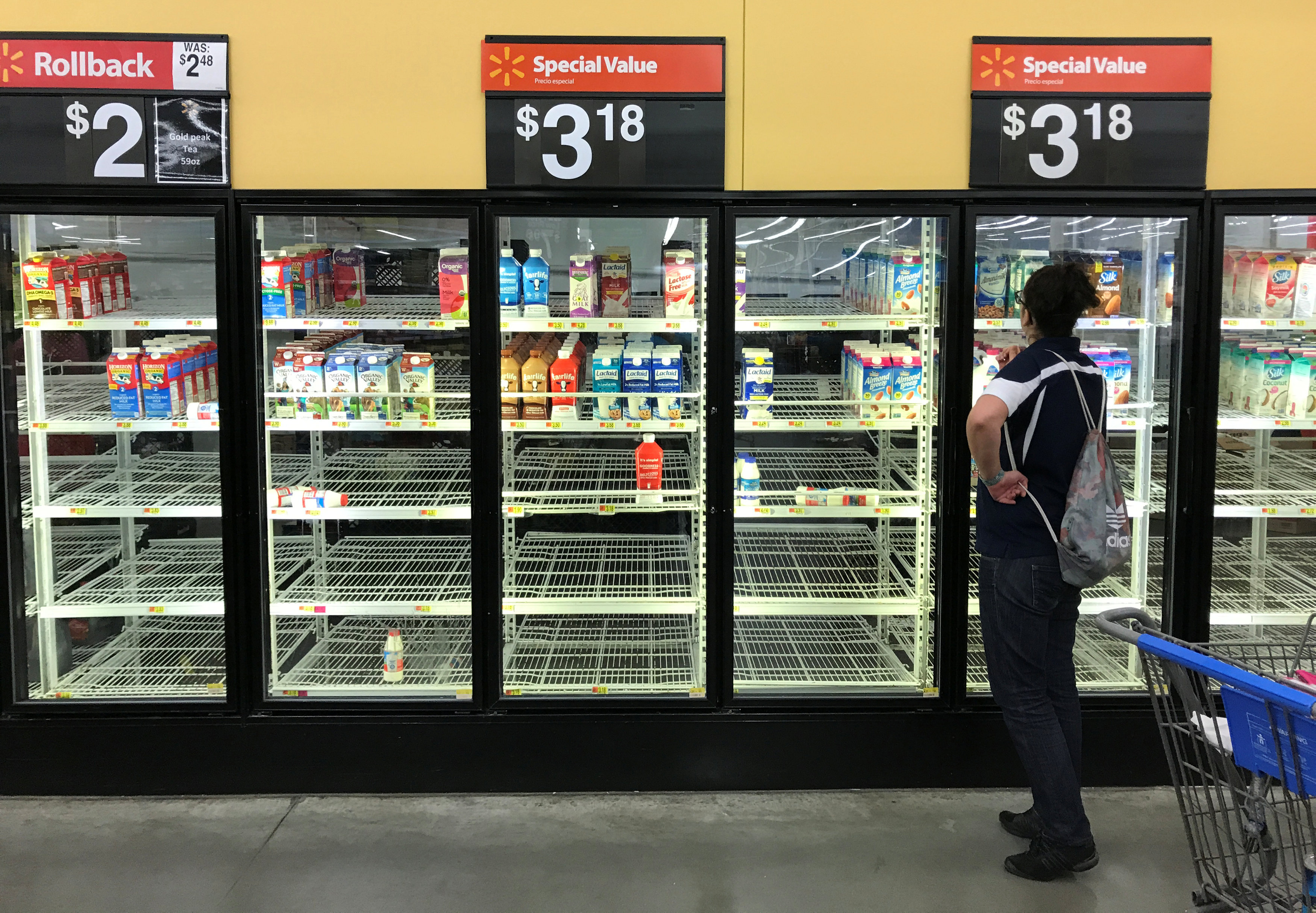 Refrigerator shelves in a Walmart store in Houston, Texas as Hurricane Harvey approaches landfall near the Texas coastal area, on Aug. 25, 2017. (REUTERS/Ernest Scheyder)