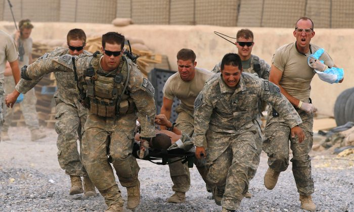 U.S. Army soldiers carry a critically wounded American soldier on a stretcher to an awaiting helicopter near Kandahar, Afghanistan, on June 10, 2010. (Justin Sullivan/Getty Images)