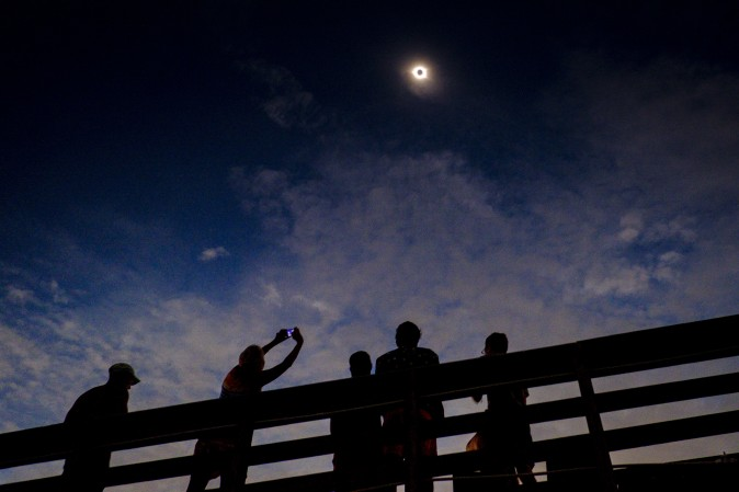 Solar eclipse watchers were ecstatic as the clouds broke minutes before totality during the total solar eclipse from the one of last vantage points where totality will be visible on August 21, 2017 in Isle of Palms, S.C. (Pete Marovich/Getty Images)