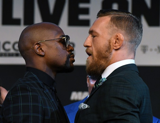Boxer Floyd Mayweather Jr. (L) and UFC lightweight champion Conor McGregor face off during a news conference at the KA Theatre at MGM Grand Hotel & Casino in Las Vegas, Nevada on Aug. 23, 2017. The two will meet in a super welterweight boxing match at T-Mobile Arena on Aug. 26 in Las Vegas. (Ethan Miller/Getty Images)