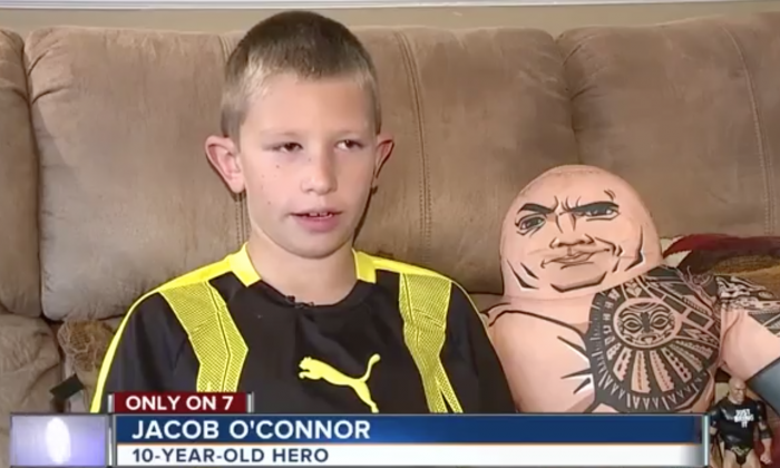 Jacob O'Connor sits with The Rock's WWE Wrestling Buddy during an interview with WKYZ on Aug 23. (Screenshot via WKYZ)