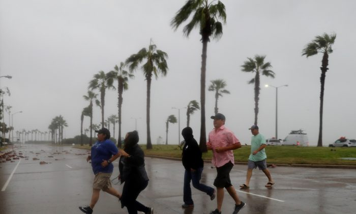 A group of people race across the street as winds from Hurricane Harvey escalated in Corpus Christi, Texas, U.S. August 25, 2017. (Reuters/Adrees Latif)