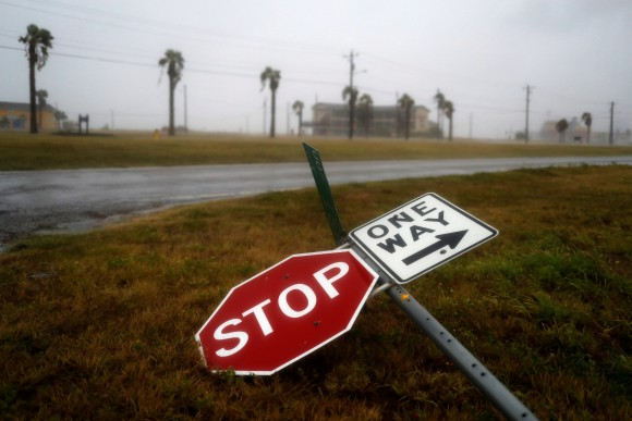 Street signs lie on the ground after winds from Hurricane Harvey escalated in Corpus Christi, Texas, U.S. August 25, 2017. (Reuters/Adrees Latif)