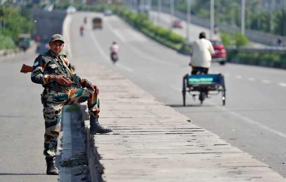 Soldiers patrol the streets in Panchkula, India August 26, 2017. (Reuters/Cathal McNaughton)