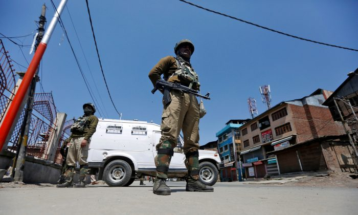 Indian policemen guard a deserted street during restrictions in downtown Srinagar April 10, 2017. (Reuters/Danish Ismail/Files)